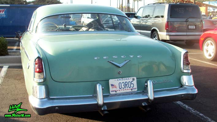 Photo of a turquoise 1955 Chrysler DeSoto Firedome 2 Door Hardtop Coupe at the Scottsdale Pavilions Classic Car Show in Arizona. Rearview of a 1955 DeSoto Firedome