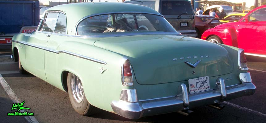 Photo of a turquoise 1955 Chrysler DeSoto Firedome 2 Door Hardtop Coupe at the Scottsdale Pavilions Classic Car Show in Arizona. Tailfins of a 55 DeSoto Firedome Coupe