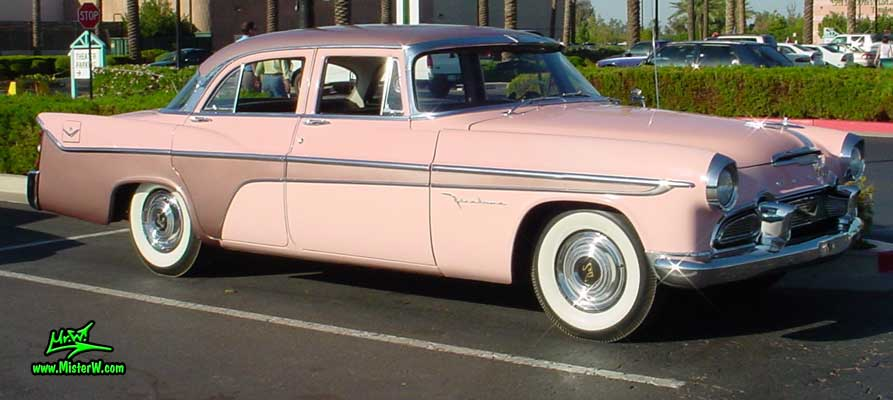 Photo of a pink 1956 Chrysler DeSoto Firedome 4 Door Hardtop Sedan at the Scottsdale Pavilions Classic Car Show in Arizona. Frontview of a 1956 DeSoto Firedome Sedan