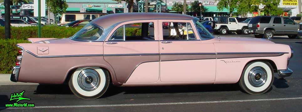 Photo of a pink 1956 Chrysler DeSoto Firedome 4 Door Hardtop Sedan at the Scottsdale Pavilions Classic Car Show in Arizona. Sideview of a 1956 DeSoto Firedome Sedan