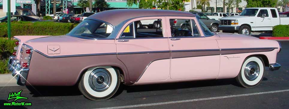 Photo of a pink 1956 Chrysler DeSoto Firedome 4 Door Hardtop Sedan at the Scottsdale Pavilions Classic Car Show in Arizona. Rearview of a 1956 DeSoto Firedome Sedan