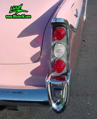 Photo of a pink 1956 Chrysler DeSoto Firedome 4 Door Hardtop Sedan at the Scottsdale Pavilions Classic Car Show in Arizona. Tail Lights of a 1956 DeSoto Firedome Sedan