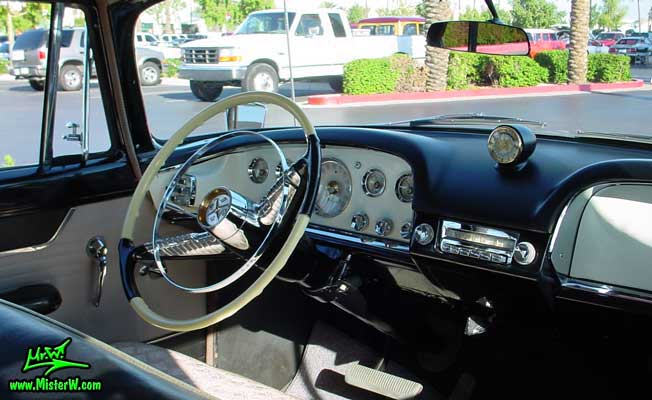 Photo of a pink 1956 Chrysler DeSoto Firedome 4 Door Hardtop Sedan at the Scottsdale Pavilions Classic Car Show in Arizona. Dashboard of a 1956 DeSoto Firedome Sedan