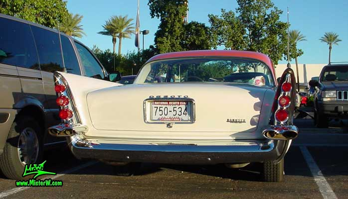 Photo of a white 1958 Chrysler DeSoto Firedome 2 Door Hardtop Coupe at the Scottsdale Pavilions Classic Car Show in Arizona. Tail Fins of a 1958 DeSoto Firedome Coupe