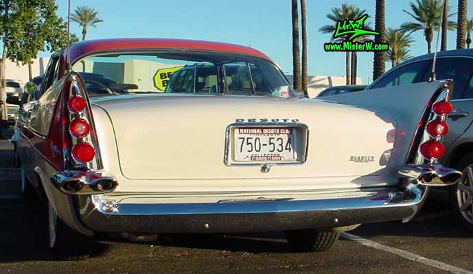 Photo of a white 1958 Chrysler DeSoto Firedome 2 Door Hardtop Coupe at the Scottsdale Pavilions Classic Car Show in Arizona. Rearview of the huge fins of a 1958 DeSoto Firedome Coupe