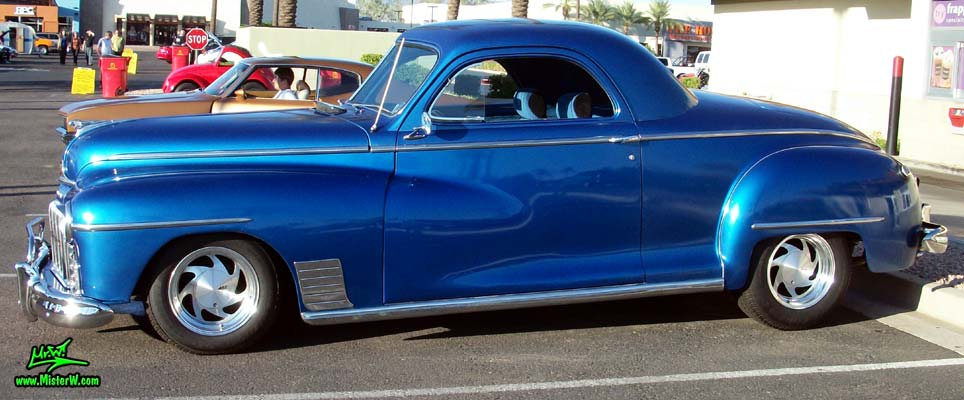 Photo of a blue metallic 1948 Dodge 3 Window Coupe at the Scottsdale Pavilions Classic Car Show in Arizona. 1948 Dodge 3 Window 2 Door Hardtop Coupe