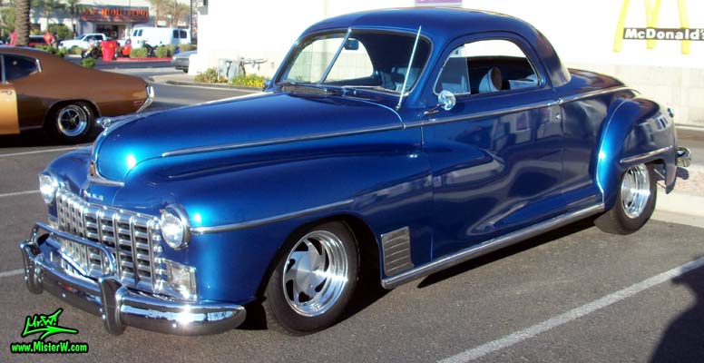 Photo of a blue metallic 1948 Dodge 3 Window Coupe at the Scottsdale Pavilions Classic Car Show in Arizona. 48 Dodge 3 Window Coupe