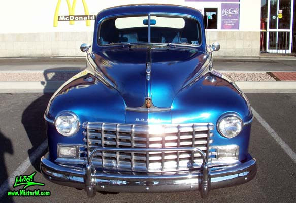 Photo of a blue metallic 1948 Dodge 3 Window Coupe at the Scottsdale Pavilions Classic Car Show in Arizona. Frontview of a 1948 Dodge 3 Window Coupe