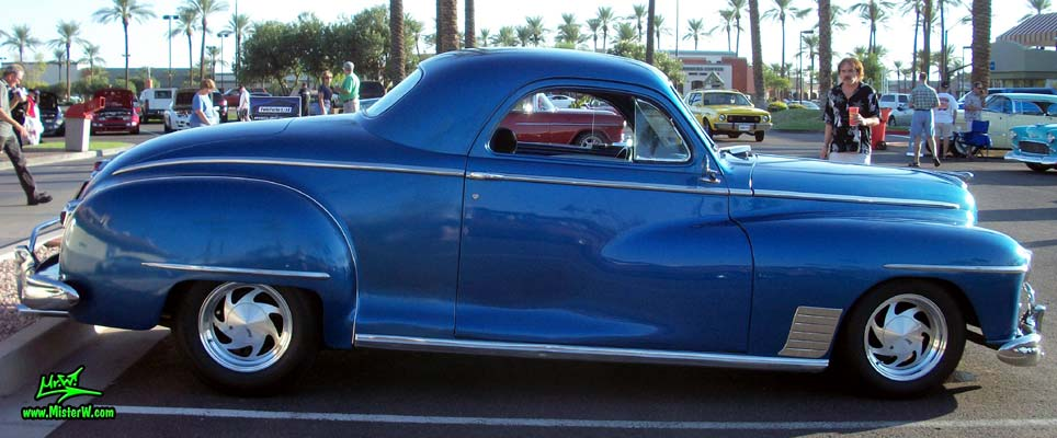 Photo of a blue metallic 1948 Dodge 3 Window Coupe at the Scottsdale Pavilions Classic Car Show in Arizona. Sideview of a 1948 Dodge 3 Window Coupe