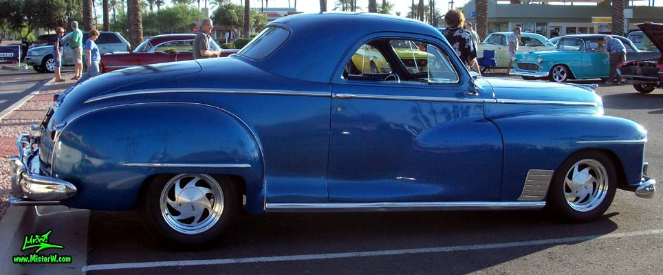 Photo of a blue metallic 1948 Dodge 3 Window Coupe at the Scottsdale Pavilions Classic Car Show in Arizona. 1948 Dodge 3 Window Coupe Passernger Side