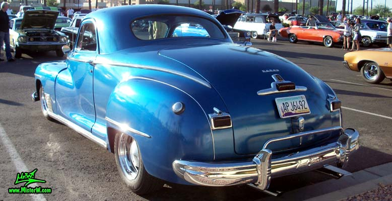 Photo of a blue metallic 1948 Dodge 3 Window Coupe at the Scottsdale Pavilions Classic Car Show in Arizona. Rearview of a 1948 Dodge 3 Window Coupe