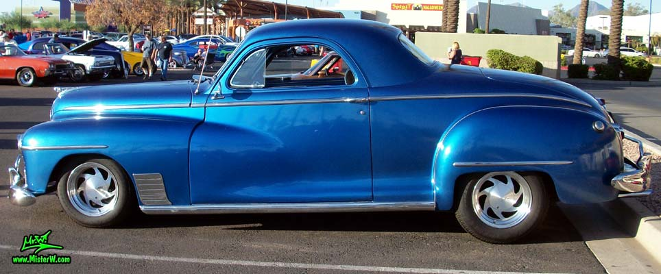 Photo of a blue metallic 1948 Dodge 3 Window Coupe at the Scottsdale Pavilions Classic Car Show in Arizona. 48 Dodge 3 Window Hardtop Coupe Driver Side