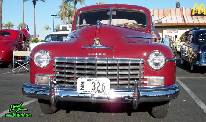 Photo of a red 1948 Dodge 5 Window Coupe at the Scottsdale Pavilions Classic Car Show in Arizona. Frontview of a 1948 Dodge 5 Window Coupe