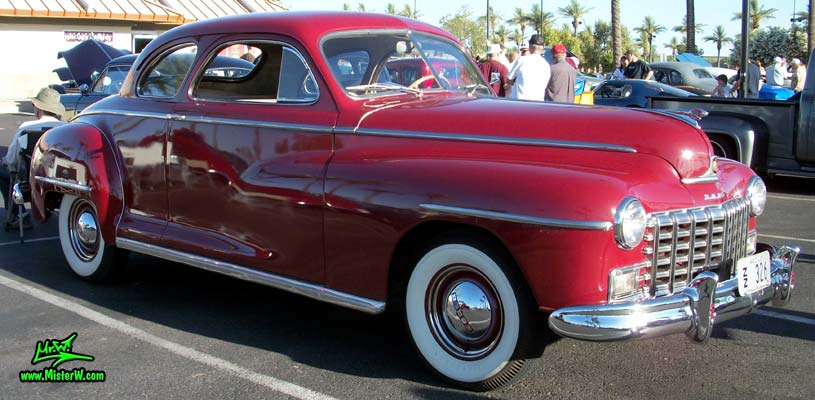Photo of a red 1948 Dodge 5 Window Coupe at the Scottsdale Pavilions Classic Car Show in Arizona. Red 48 Dodge Coupe