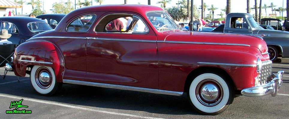 Photo of a red 1948 Dodge 5 Window Coupe at the Scottsdale Pavilions Classic Car Show in Arizona. 48 Dodge 5 Window Coupe Passenger Side