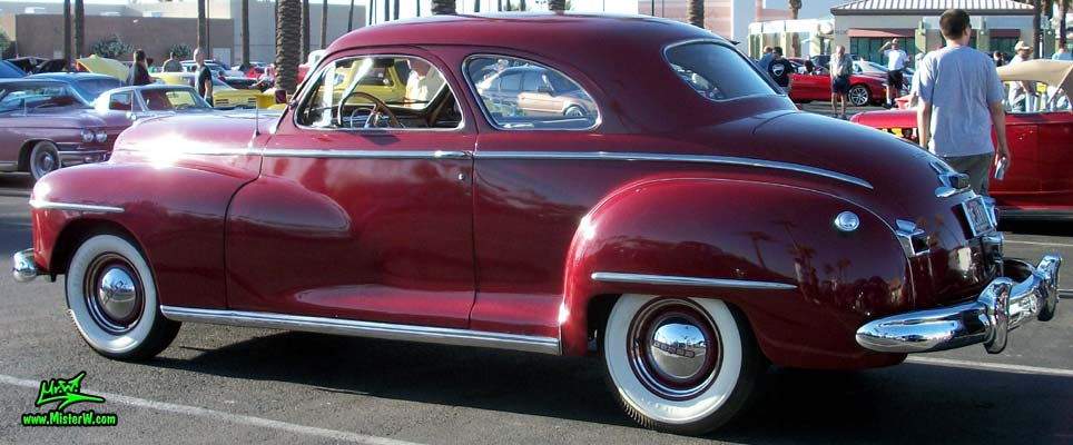 Photo of a red 1948 Dodge 5 Window Coupe at the Scottsdale Pavilions Classic Car Show in Arizona. 1948 Dodge