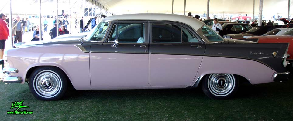 Photo of a white, pink & charcoal grey 1956 Chrysler Dodge Royal 4 Door Sedan at a Classic Car Auction in Scottsdale, Arizona. Sideview of a 1956 Dodge Royal