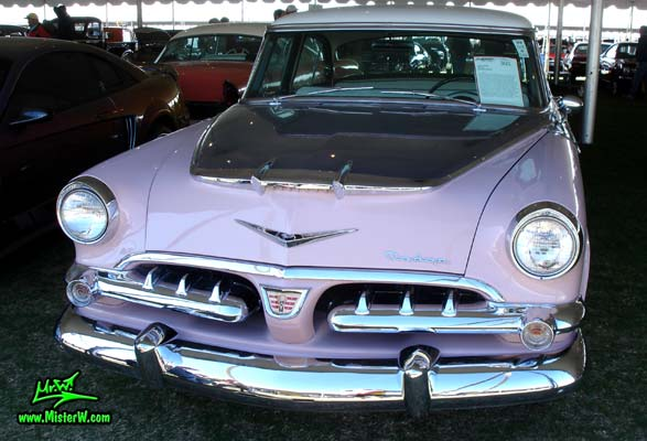 Photo of a white, pink & charcoal grey 1956 Chrysler Dodge Royal 4 Door Sedan at a Classic Car Auction in Scottsdale, Arizona. Frontview of a 1956 Dodge Royal