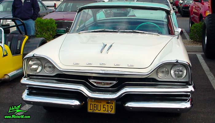 Photo of a white & turquoise 1957 Chrysler Dodge Coronet 2 Door Hardtop Coupe at the Scottsdale Pavilions Classic Car Show in Arizona. 1957 Dodge