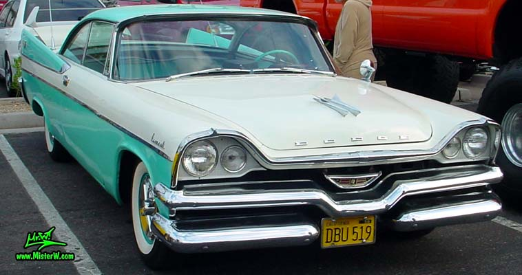 Photo of a white & turquoise 1957 Chrysler Dodge Coronet 2 Door Hardtop Coupe at the Scottsdale Pavilions Classic Car Show in Arizona. 1957 Dodge Coupe