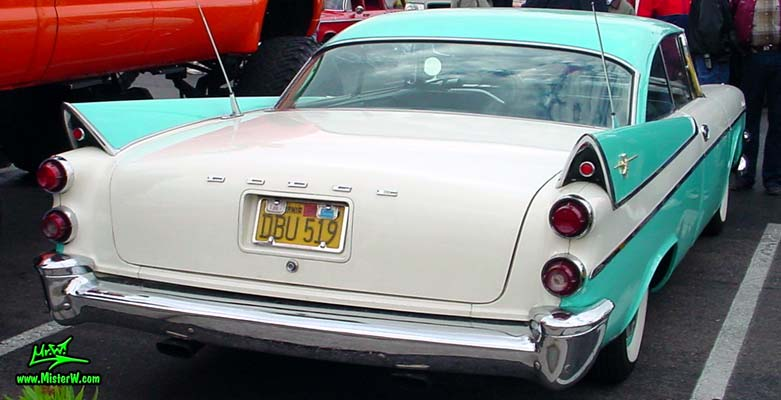 Photo of a white & turquoise 1957 Chrysler Dodge Coronet 2 Door Hardtop Coupe at the Scottsdale Pavilions Classic Car Show in Arizona. Tail Fins of a 57 Dodge Coronet Coupe