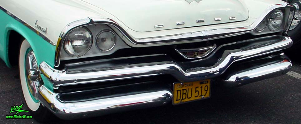 Photo of a white & turquoise 1957 Chrysler Dodge Coronet 2 Door Hardtop Coupe at the Scottsdale Pavilions Classic Car Show in Arizona. Chrome Grill & Front Bumper of a 57 Dodge