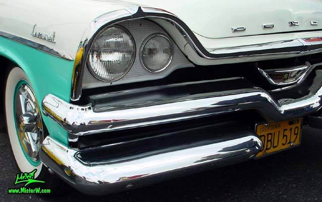 Photo of a white & turquoise 1957 Chrysler Dodge Coronet 2 Door Hardtop Coupe at the Scottsdale Pavilions Classic Car Show in Arizona. Head Light of a 57 Dodge Coronet