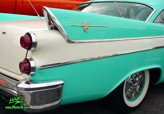 Photo of a white & turquoise 1957 Chrysler Dodge Coronet 2 Door Hardtop Coupe at the Scottsdale Pavilions Classic Car Show in Arizona. Tail Fin & Crome Trim of a 57 Dodge Coronet