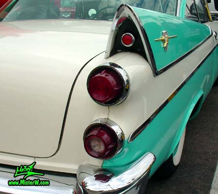 Photo of a white & turquoise 1957 Chrysler Dodge Coronet 2 Door Hardtop Coupe at the Scottsdale Pavilions Classic Car Show in Arizona. 1957 Dodge Tailfin & Rear Light