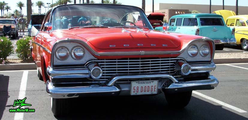 Photo of a red & white 1958 Chrysler Dodge Coronet 2 Door Hardtop Coupe at the Scottsdale Pavilions Classic Car Show in Arizona. Front Grill of a 58 Dodge Coronet