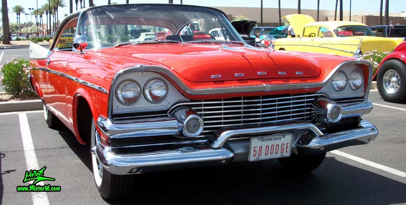 Photo of a red & white 1958 Chrysler Dodge Coronet 2 Door Hardtop Coupe at the Scottsdale Pavilions Classic Car Show in Arizona. 58 Dodge Front