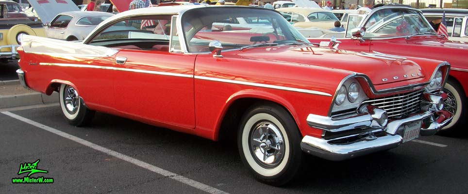 Photo of a red & white 1958 Chrysler Dodge Coronet 2 Door Hardtop Coupe at the Scottsdale Pavilions Classic Car Show in Arizona. 58 Dodge Coupe
