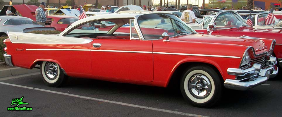 Photo of a red & white 1958 Chrysler Dodge Coronet 2 Door Hardtop Coupe at the Scottsdale Pavilions Classic Car Show in Arizona. 58 Dodge Coronet
