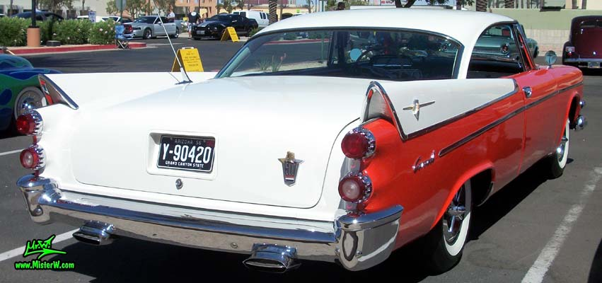 Photo of a red & white 1958 Chrysler Dodge Coronet 2 Door Hardtop Coupe at the Scottsdale Pavilions Classic Car Show in Arizona. Red & whire Fins of a 58 Dodge Coupe