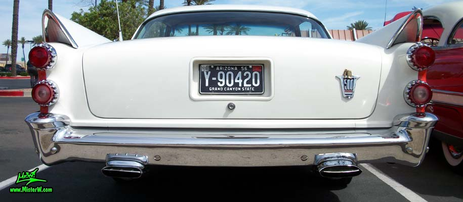 Photo of a red & white 1958 Chrysler Dodge Coronet 2 Door Hardtop Coupe at the Scottsdale Pavilions Classic Car Show in Arizona. Rearview of a 1958 Dodge Coronet Coupe