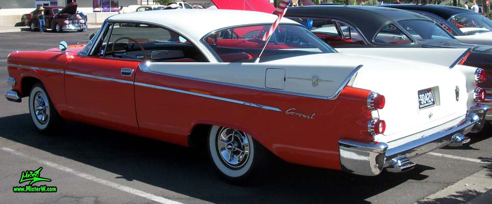Photo of a red & white 1958 Chrysler Dodge Coronet 2 Door Hardtop Coupe at the Scottsdale Pavilions Classic Car Show in Arizona. 58 Dodge Coronet Coupe