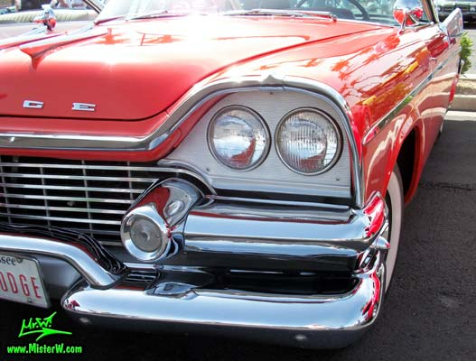 Photo of a red & white 1958 Chrysler Dodge Coronet 2 Door Hardtop Coupe at the Scottsdale Pavilions Classic Car Show in Arizona. 1958 Dodge Head Lights