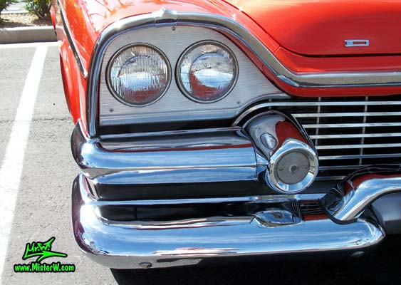 Photo of a red & white 1958 Chrysler Dodge Coronet 2 Door Hardtop Coupe at the Scottsdale Pavilions Classic Car Show in Arizona. Headlight of a 58 Dodge Coronet Coupe