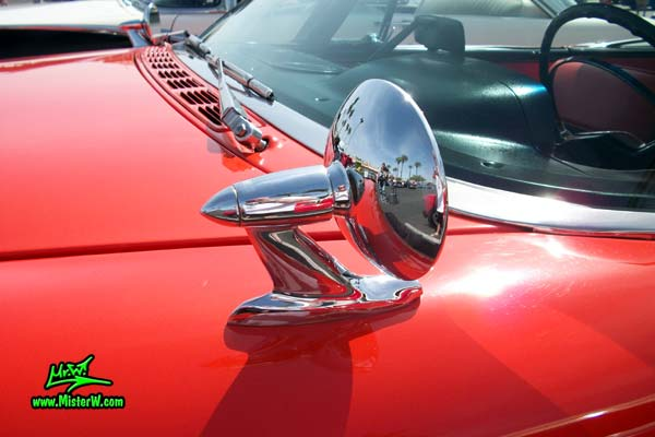Photo of a red & white 1958 Chrysler Dodge Coronet 2 Door Hardtop Coupe at the Scottsdale Pavilions Classic Car Show in Arizona. Driverside Mirror of a 1958 Dodge Coronet Coupe