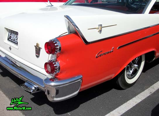 Photo of a red & white 1958 Chrysler Dodge Coronet 2 Door Hardtop Coupe at the Scottsdale Pavilions Classic Car Show in Arizona. Tailfin of a 1958 Dodge Coronet Coupe