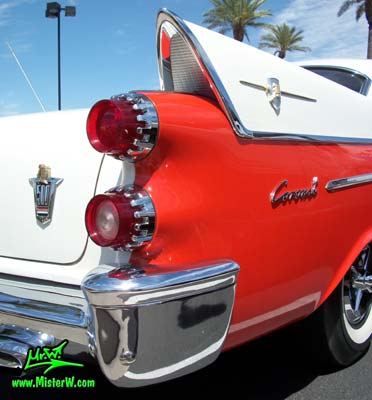 Photo of a red & white 1958 Chrysler Dodge Coronet 2 Door Hardtop Coupe at the Scottsdale Pavilions Classic Car Show in Arizona. Taillights of a 1958 Dodge Coronet Coupe
