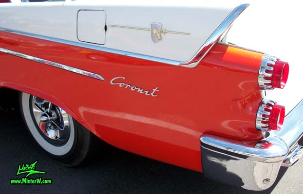 Photo of a red & white 1958 Chrysler Dodge Coronet 2 Door Hardtop Coupe at the Scottsdale Pavilions Classic Car Show in Arizona. Chrome Emblem of a 58 Dodge Coronet