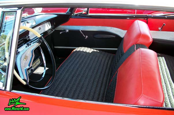 Photo of a red & white 1958 Chrysler Dodge Coronet 2 Door Hardtop Coupe at the Scottsdale Pavilions Classic Car Show in Arizona. Front Seats of a 1958 Dodge Coronet Coupe
