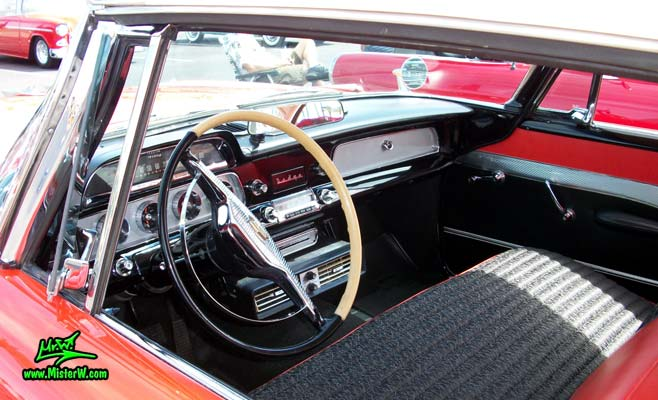 Photo of a red & white 1958 Chrysler Dodge Coronet 2 Door Hardtop Coupe at the Scottsdale Pavilions Classic Car Show in Arizona. 1958 Dodge Dash Board