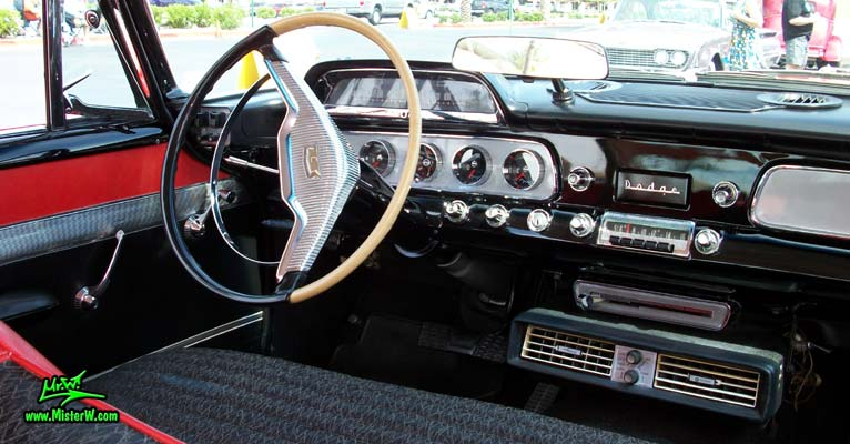 Photo of a red & white 1958 Chrysler Dodge Coronet 2 Door Hardtop Coupe at the Scottsdale Pavilions Classic Car Show in Arizona. Dash & Speedometer of a 58 Dodge