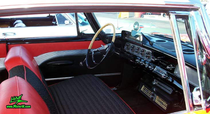 Photo of a red & white 1958 Chrysler Dodge Coronet 2 Door Hardtop Coupe at the Scottsdale Pavilions Classic Car Show in Arizona. Interior of a 58 Dodge