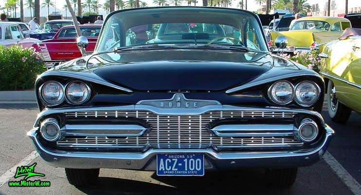 Photo of a black 1959 Chrysler Dodge Coronet 2 Door Hardtop Coupe at the Scottsdale Pavilions Classic Car Show in Arizona. Frontview of a 1959 Dodge Coronet Hardtop Coupe