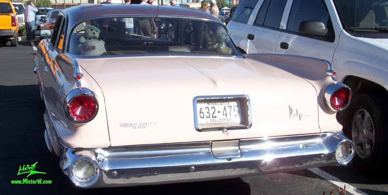 Photo of a pink 1960 Dodge Pioneer 4 door sedan at the Scottsdale Pavilions Classic Car Show in Arizona. Rearview of a 1960 Dodge Pioneer sedan