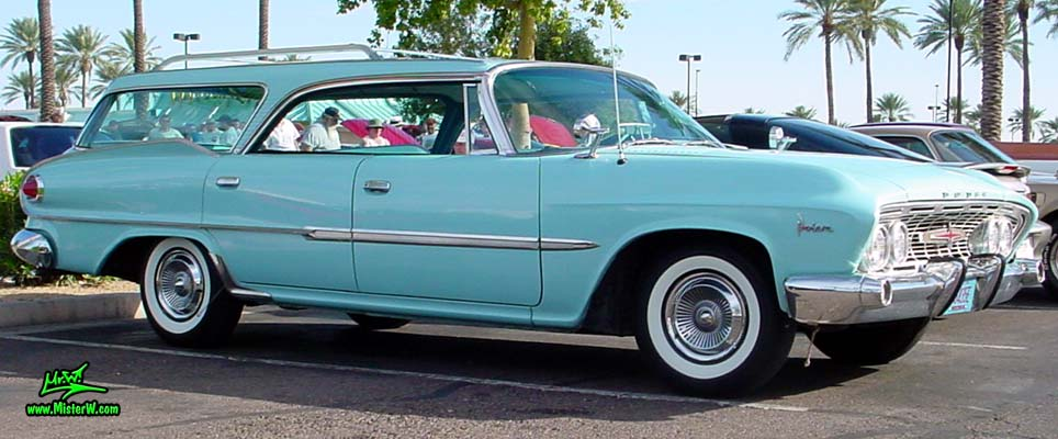 Photo of a turquoise 1961 Dodge Polara 4 door hardtop station wagen at the Scottsdale Pavilions Classic Car Show in Arizona. Sideview of a 1961 Dodge Polara station wagen