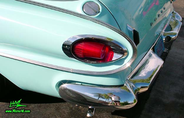 Photo of a turquoise 1961 Dodge Polara 4 door hardtop station wagen at the Scottsdale Pavilions Classic Car Show in Arizona. Tail light of a 1961 Dodge Polara station wagen